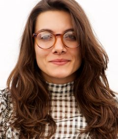 trendy-woman-in-glasses-standing-by-white-wall-5NF8L4S-1.jpg
